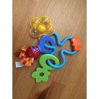 Развивающаяся игрушка Playgro, разные материалы, цветная и красочная, прорезыватели для зубов. Состояние отличное. Размер 19 на 15 см.