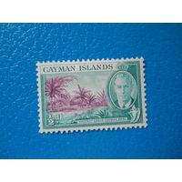 Каймановы о-ва. 1950 г. Мi-123. Георг VI. Кокосовые пальмы.