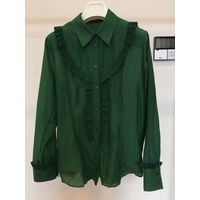 Зеленая блузка Rochas с оборками.