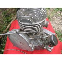 Похоже  новый  двигатель  Д-6 с газовым  тросиком для  газовых  советских  мопедов.