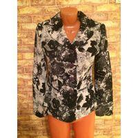 Шикарный пиджак на 44-46 размер. Очень хорошего качества. Смотрится дорого и стильно сочетание цветов: черный, серый и светлый.