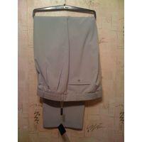 Фирменные брюки Broswil на размер 58-182. Отличное качество, красивая модель. Хороший состав: 70% вискоза, 45% полиэстер. Германия ПОталии 52,5 см, длина 113 см.