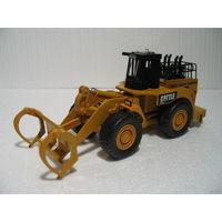 Трактор-погрузчик CATERPILLAR электрофицирован