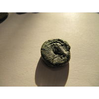 Старинная монета с головой лошади
