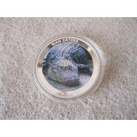 Монета номиналом 100 шиллингов. Аллигатор. Уганда, 2010 год. Серия: животные-людоеды.