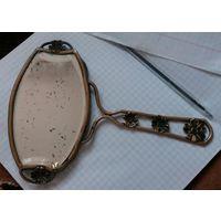 Старинное ручное зеркало.