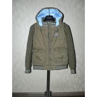 Фирменная куртка  . Произведена в Германии.