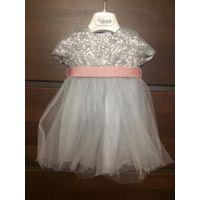 Очаровательное платье для малышки 3-6 мес. Верх красиво украшен пайетками, красивая пышная юбка. Идеальное состояние.