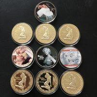 """Сувенирные монеты """"МЕРИЛИН МОНРО"""" ПОЗОЛОТА+ЦВЕТНАЯ ЭМАЛЬ (10 монет) Диаметр 40мм."""