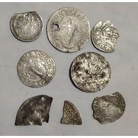Обломки серебряных монет.