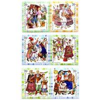 Украина 2005 г.   Украинская народная одежда.   (3 сцепки - 6 марок) *