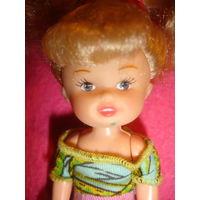 Маленькая куколка кукла