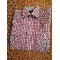 Красивая рубашка в клетку сиреневого цвета на 48 размер. Размер M(39-40). 100% хлопок. Длина 68см, ПОгруди 54 см,  длина рукава 59 см. Есть потертость воротничка, необходимо перешить на другую сторону