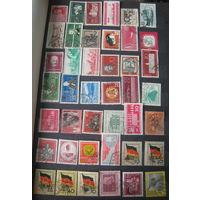 Альбом с марками Германии (ГДР). Более 600 марок с 1956 года вместе с альбомом