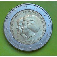 2 евро 2013 Голландия (памятная) Объявление королевы Нидердандов Беатрикс о передаче трона наследному принцу Виллему-Александру