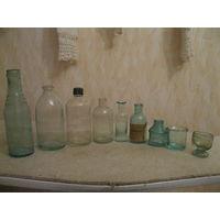 Девять старых медицинских бутылочек одним лотом.