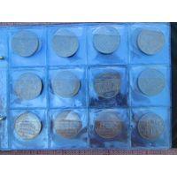 Полный комплект юбилейных рублей СССР-64 монеты в альбоме.
