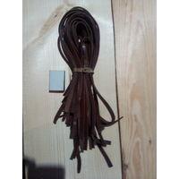 Кожаные ремни длиной около 55 см. каждый