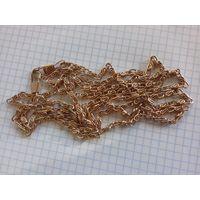 Цепочка золотого цвета 115 см., 33 грамма