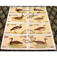 Птицы (гуси) на марках Омана.