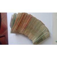 Куча денег. Банкноты номиналами 50-100-500-1000 рублей 2000 года