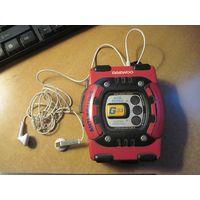 Аудиоплеер Daewoo с кассетой и наушниками.