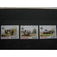 Марки - Мозамбик, фауна, слоны, охота техника вертолеты авиация