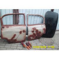 """Запчасти для """"Волга ГАЗ-21"""" . Двери, капот, задние фонари, приборная панель и коробка передач."""